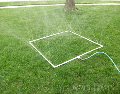 pvc pipe sprinkler water toy on grass with hose & 5 Summer DIY Projects Using PVC Pipe