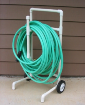 DIY PVC Water Hose Caddy with Wheels and green Garden Hose
